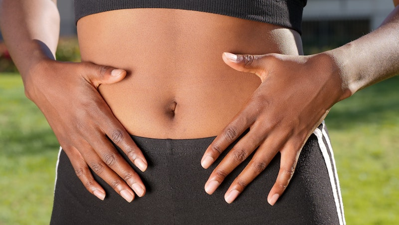 woman-holding-hands-against-stomach